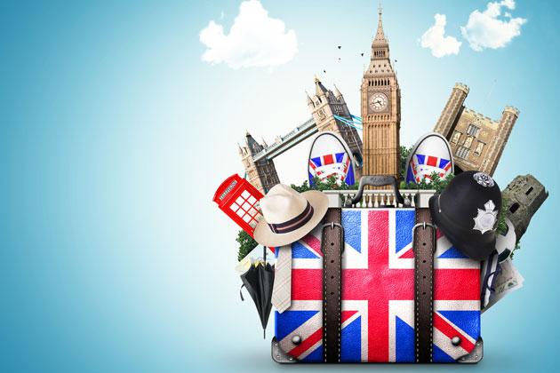 mala de viagem com a bandeira de inglaterra e diversos pontos turísticos do país em um fundo de céu